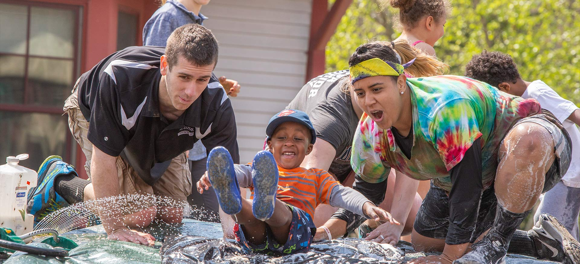 Students and children participating in the Fun Mudder