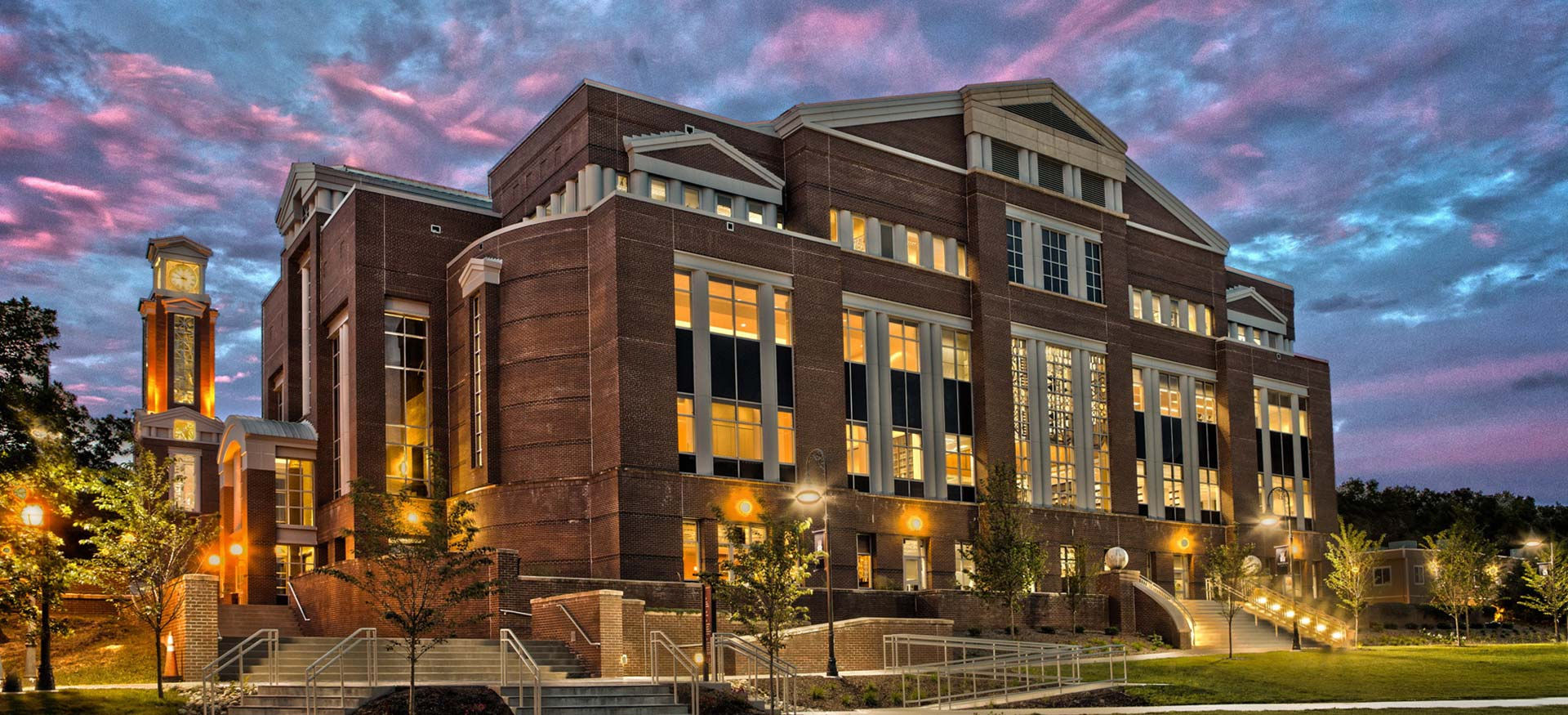 Photo of the J Eugene Smith Library and clock tower at dusk