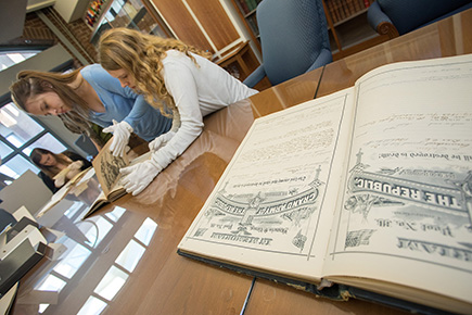 Students examining old documents