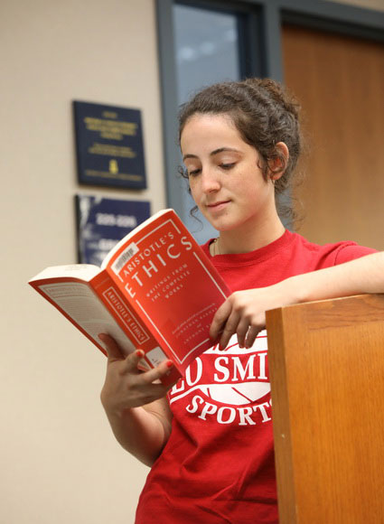 Student reading ethics book