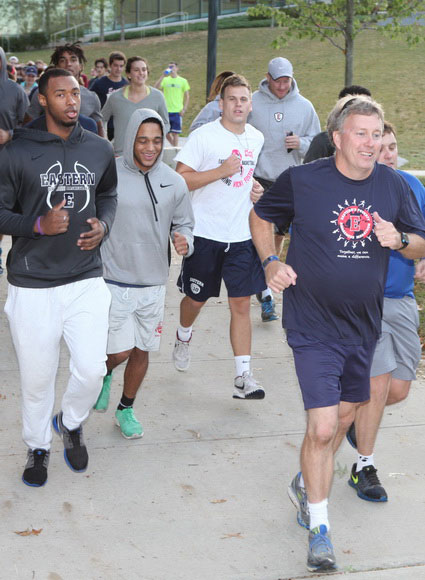 Professor and students running